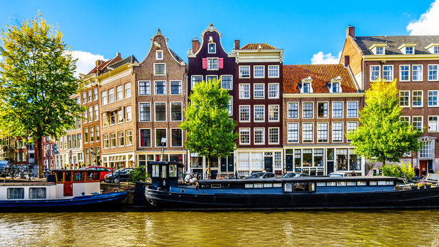 The Prinsengracht (Prince Canal) at the Leliegracht (Lelie Canal) with its many historic houses and ornate gables in the center of Amsterdam