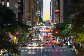 Colorful night lights of a busy scene on 42nd Street in Midtown Manhattan, New York City Fotomurales