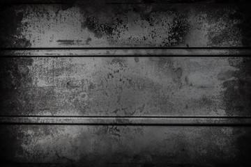 Dark black Metallic wall background texture with dark vignetting. Grunge surface
