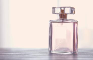 Image of elegant perfume bottle. back light photo. vintage filtered image.