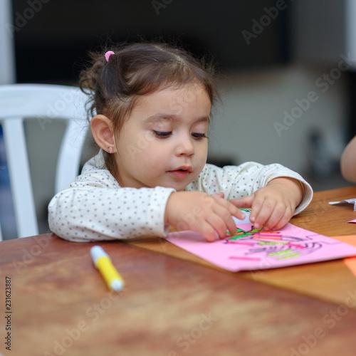 Needlework, crafts children Little Toddler Girl Play With