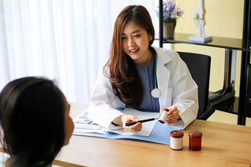 Beautiful physician medicine doctor or pharmacist  reading notes of  boxes medicine,Medical care, pharmacy or insurance concept