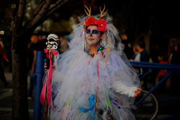A woman in costume attends the Dia de los Muertos parade in Albuquerque