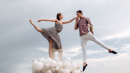 High flying romance. Ballet couple into love relations. Romantic relations between ballerina and ballet partner. Couple in love. Ballet dancers falling in love. Reaching the sky