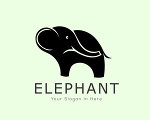 stand elephant logo looking back design inspiration