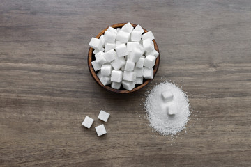 Various types of sugar, white sugar on wooden table.