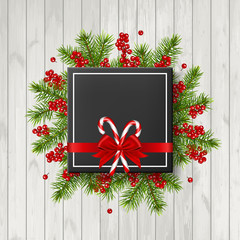 christmas background with fir tree, candy and bow,  isolated on wood background