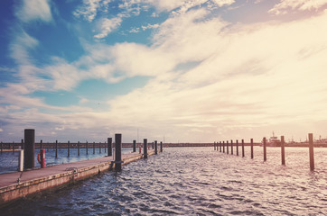 Vintage stylized picture of an empty marina in Sassnitz at sunset, Germany.