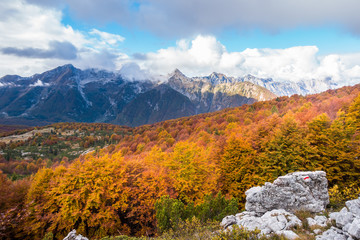 Beauty colorful autumn mountain landscape with cloudy sky.