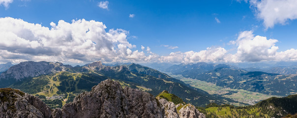 Mountain landscape with blue sky and clouds. Alps, Austria, Nassfeld.