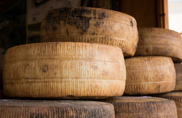 Handmade local cheese assortment, on a fair of traditional products.