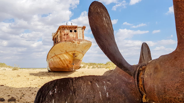 Old wreck of boat on the sand in Aral sea.