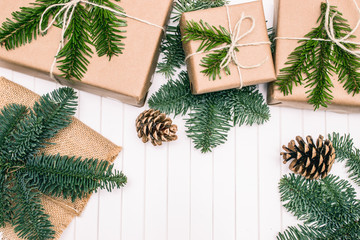 christmas gift. Xmas gifts on wooden background. christmas presents with Fir tree branches. Xmas greeting card and border with copy space
