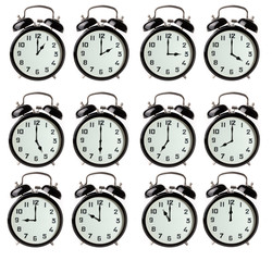 Iconic alarm clocks showing different hours isolated on white