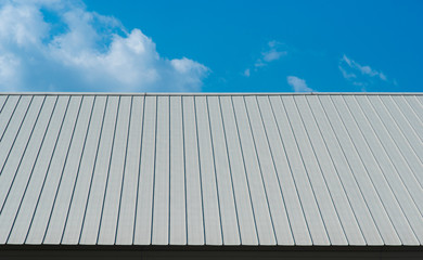 Metal sheet for industrial roof and blue sky.