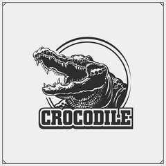 The emblem with crocodile. Vector monochrome illustration.