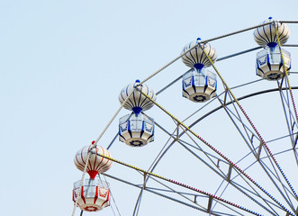 ferris wheel with the blue sky