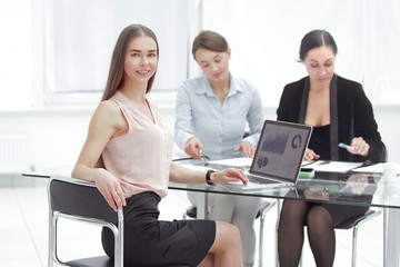 business meeting, business woman Explain analyze the company's sales plan