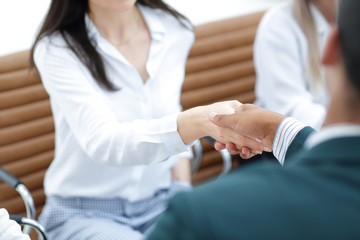businesswoman shaking hands with partner at office meeting