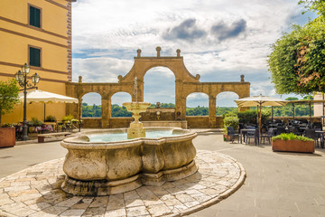 View at the fountain of Place of the Republic in Pitigliano - Italy