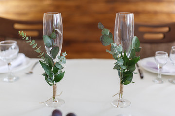 two decorated glasses. dishes on the festive table. festive table in the restaurant.