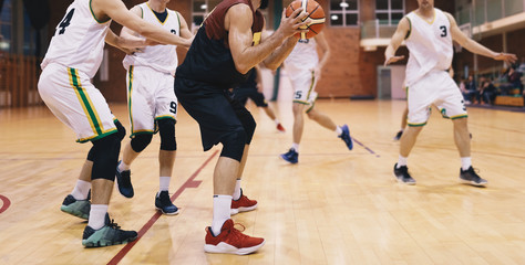Basketball Players in Action. High School Basketball Team Playing Game