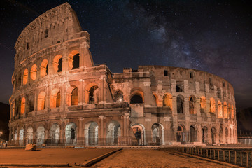 Coliseum in Rome by Night with milky way-  Colosseum is one of the main travel attractions - The Main symbol of Rome