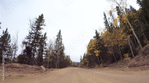 Wall mural Time lapse. Driving on small mountain dirt roads from Colorado Springs to Cripple Creek in Autumn.