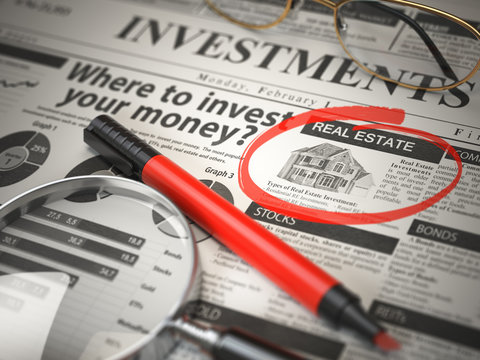 Real Estate is a best option to invest. Where to Invest concept, Investmets newspaper with loupe and marker.
