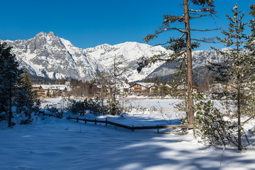 Seefeld lake in Tyrol on a sunny winter day with view to the village