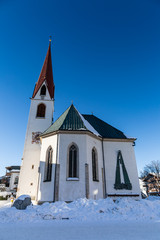 church in winter sport region Seefeld on sunny winter day