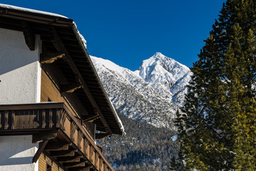 Seefeld traditional wood house and mountain scenery covered in snow