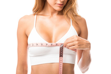 Woman Measuring Her Chest Size Over White Background