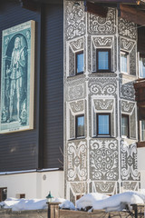 Traditional ornamented painted facade of Tyrolean building in Seefeld