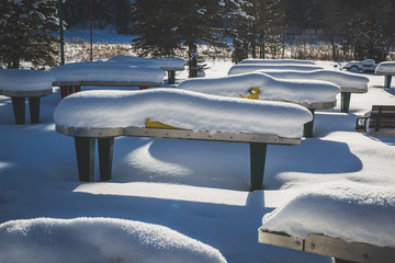 Miniature golf stations covered in snow on sunny winter day