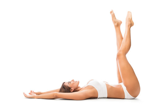 Happy Model With Feetup Lying Against White Background