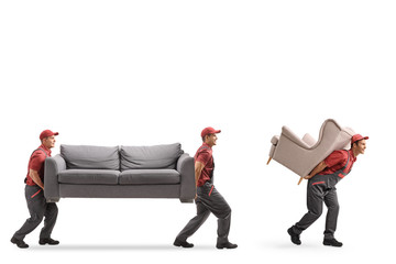 Movers carrying a couch and an armchair