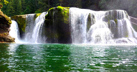 Beautiful Cascading Falls Over Mossy Rocks Into Shallow Pool With Mist - Lewis River Falls, Washington, USA - Low Approaching View