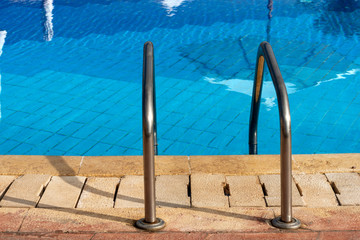 Swimming Pool with a Steel Ladder
