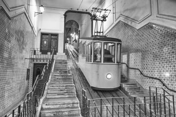 Yellow Tram, Ascensor da Bica at night - Lisbon, Portugal