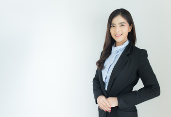 Portrait of young asian business woman welcoming gesture over white background.