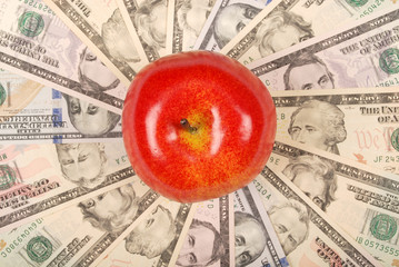 Red apple on mandala kaleidoscope from money.