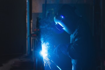 Worker using welding torch in rope making industry