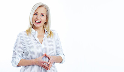 Attractive middle aged woman with folded arms isolated on white background
