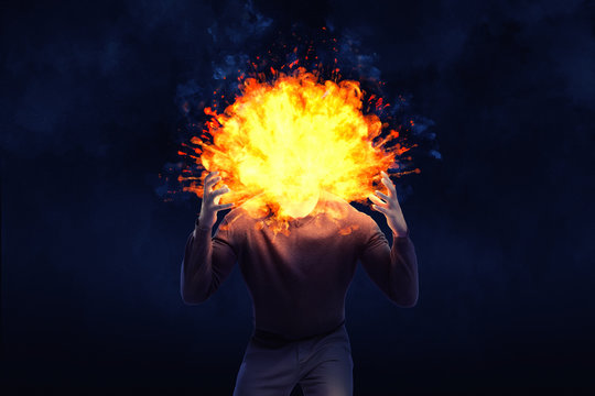 A dark shape of an angry man with an exploding head on a black background.