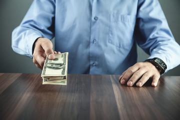 Caucasian businessman showing money in his desk.