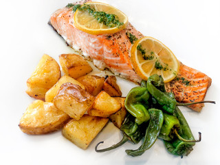 Grilled Salmon Steak with Prepared Potatoes and Peppers