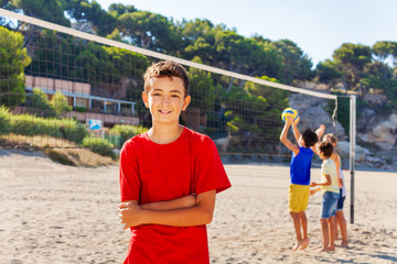Young volleyball player on the court after game