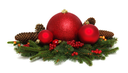Christmas decoration: red balls with cones and fir tree branches
