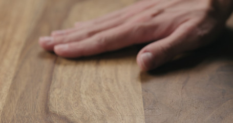 man hand check quality of polisander wood surface Wall mural